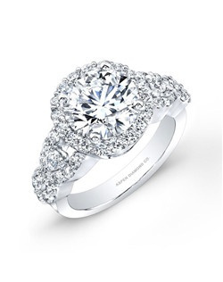 Round brilliant diamond, 1.20 carats; side diamond total weight 2.30 carats; 18K white gold setting