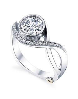 The Aurora engagement ring contains 24 diamonds, totaling 0.1025 ctw. Shown with a 1ct center diamond. Center stone sold separately, not included in price. Available in yellow, white, or rose gold, and platinum. Rings can be custom made to fit any size or shape diamond or color center stone. Price excludes center stone