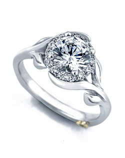 The Bloom engagement ring contains 15 diamonds, totaling 0.18 ctw. Shown with a 1ct center diamond. Center stone sold separately, not included in price. Available in yellow, white, or rose gold, and platinum. Rings can be custom made to fit any size or shape diamond or color center stone. Price excludes center stone