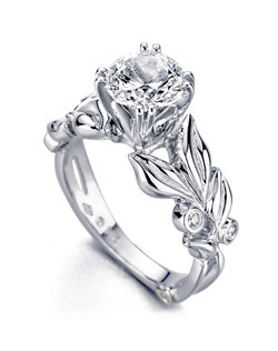 The Flora engagement ring contains 5 diamonds, totaling 0.065 ctw. Shown with a 1ct center diamond. Center stone sold separately, not included in price. Available in yellow, white, or rose gold, and platinum. Rings can be custom made to fit any size or shape diamond or color center stone. Price excludes center stone
