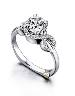 The Infinity engagement ring contains 26 diamonds, totaling 0.11ctw. Shown with a 1ct center diamond. Center stone sold separately, not included in price. Available in yellow, white, or rose gold, and platinum. Rings can be custom made to fit any size or shape diamond or color center stone. Price excludes center stone