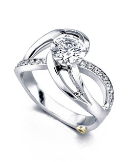 The Kismet engagement ring contains 19 diamonds, totaling 0.185ctw. Shown with a 1ct center diamond. Center stone sold separately, not included in price. Available in yellow, white, or rose gold, and platinum. Rings can be custom made to fit any size or shape diamond or color center stone. Price excludes center stone