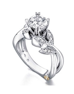 The Mystic engagement ring contains 15 diamonds, totaling 0.145ctw. Shown with a 1ct center diamond. Center stone sold separately, not included in price. Available in yellow, white, or rose gold, and platinum. Rings can be custom made to fit any size or shape diamond or color center stone. Price excludes center stone