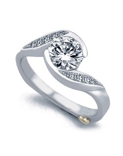 The Whirlwind engagement ring contains 11 diamonds, totaling 0.085ctw. Shown with a 1ct center diamond. Center stone sold separately, not included in price. Available in yellow, white, or rose gold, and platinum. Rings can be custom made to fit any size or shape diamond or color center stone. Price excludes center stone