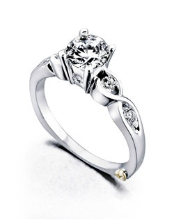 The Yours Truly engagement ring contains 5 diamonds, totaling 0.165ctw. Shown with a 1ct center diamond. Center stone sold separately, not included in price. Available in yellow, white, or rose gold, and platinum. Rings can be custom made to fit any size or shape diamond or color center stone. Price excludes center stone
