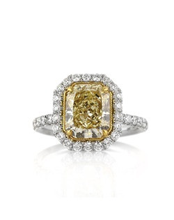 This astonishing fancy yellow radiant cut diamond ring is jaw droppingly beautiful! The gorgeous 3.12ct radiant cut diamond showcased in the center of this platinum masterpiece is GIA certified at Fancy Yellow SI1. It has a very rich, vibrant, and beautiful canary yellow color and it is perfectly eye clean. The cut is outstanding as well! It is more elongated and looks very large for its weight. The brilliance is outstanding as well. It is accented by a halo of round diamonds and a row of round diamonds set down the sides in a micropave setting. The diamonds stand out beautifully with very little metal showing. The center basket is made in high polish 18k yellow gold and hand engraved to perfection. The connectors are also studded with round diamonds for an added touch of brilliance. It is awe-inspiring! You are going to be mesmerized when you see it in person!