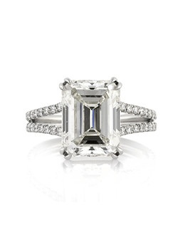This astonishing emerald cut diamond engagement ring will mesmerize you with its magnificent size, quality, and beauty! The 4.77ct emerald cut diamond poised in the center is GIA certified at L-VS1. It has a warmer white color and it is perfectly clear, even under 10X magnification. The cut and shape of the diamond is breathtaking! It is accented by two rows of round diamonds set in a micropave setting on a split shank design. This custom-made ring is made in high polish platinum. All you see are the mesmerizing diamonds with minimal metal showing. It is truly enchanting!
