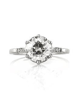 This gorgeous antique European round cut diamond engagement ring is absolutely breathtaking! The magnificent 2.08ct antique European cut poised in the center of this custom made platinum setting is EGL certified at J-VS1. It features the larger, more pronounced facets that reflect light in a mesmerizing way! It faces up white and is clear, even under 10X magnification. It is accented by two single cut round diamonds set on each side. It is absolutely gorgeous! You are going to cherish it forever!