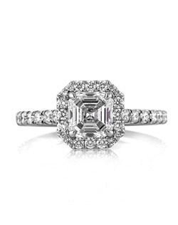 This magnificent Asscher cut diamond engagement ring is one in a million! The stunning 1.20ct Asscher cut center diamond is GIA certified at H-SI1. It is white, has a pinpoint inclusion which gives you an eye clean look. The cut, polish, and symmetry are all excellent. It is very difficult to find asscher cuts with such an outstanding combination! The 1 carat asscher is showcased beautifully with a halo of round diamonds set around it and a row set down the sides. The connectors are also studded with round diamonds for an added touch of brilliance. It is absolutely mesmerizing! You are going to cherish this magnificent piece!
