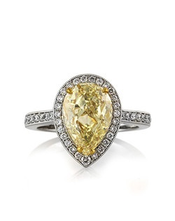 This magnificent fancy light yellow pear shaped diamond ring is so incredibly beautiful and brilliant! The 3.08ct pear shaped diamond poised in the center is GIA certified, one of the leaders in diamond grading, at Fancy Light Yellow I1. It has a very beautiful and vibrant fancy yellow color and it is eye clean. The inclusions are white feathers off to the side of the diamond, which blend in giving you that eye clean look. It is an extraordinary value! It is accented by round diamonds in a pave setting, all set on high polish platinum. The center basket is made in high polish 18k yellow gold and hand engraved throughout. It is truly amazing! Sure to become a family heirloom, cherished for generations to come!