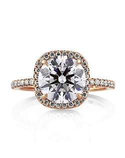Rose gold and white diamonds make for a beautiful, elegant combination on this halo diamond ring. Featured at the center of this engagement ring is a 2.04ct round brilliant cut diamond GIA certified at F-SI1. The two carat center stone has an extremely brilliant cut and faces up colorless. It is set in a cushion shaped halo micropave 18k rose gold setting. There is also a row of micropave round diamonds set down the dainty shank. The design of the ring allows for a matching band to sit completely flush with the engagement ring for a sleek, clean look. This round brilliant cut diamond engagement ring will stun audiences for a lifetime!