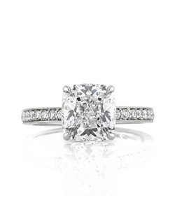 "This incredible cushion cut diamond engagement ring is truly a one of a kind, special ring. The ""wow"" factor of this ring is the 3.03ct diamond set at the center. It is GIA certified at E-VVS2, colorless and nearly flawless!  The three carat center stone is extremely bright and well proportioned. It is set on a custom designer basket set with pavé round brilliant cut diamonds. The shank of this platinum setting is also set with pavé set diamonds going three-quarters of the way down. Simply spectacular and well made, this cushion cut diamond engagement ring will be the center of attention in any room."
