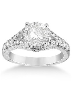 When you're ready to tie the knot, do it with this antique style art deco diamond engagement ring setting in 14k white gold. It features milgrain edges with 20 round cut diamonds lining the split band. The pave set diamonds are of G-H color and VS2-SI1 clarity, and have an approximate total carat weight of 0.33cts. Build your own solitaire antique style art deco diamond engagement ring setting by selecting a center diamond from our expanding selection of conflict-free diamonds.