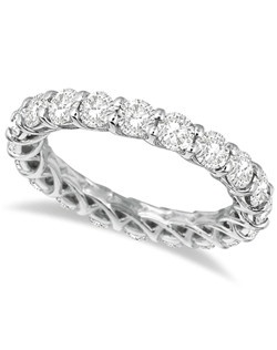 A unique design and 3.50 carats of brilliant cut round diamonds combine to form an elegant eternity band beautifully crafted in 14kt white gold. This modern ladies' ring features 20 diamonds that go all the way around the band. The diamonds are of G-H Color and SI1-SI2 Clarity. Wear this ring as a standalone right hand fashion ring, wear it as a wedding band, or as an anniversary ring.