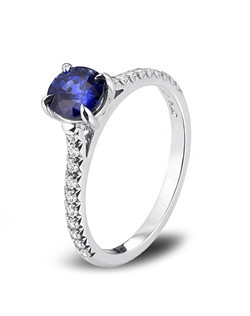 Fusaro petite style ring with oval sapphire and diamonds set in platinum.