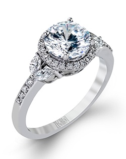 14K white gold ring comprised of 0.15ctw round white diamonds and 0.19ctw marquise diamonds.  excluding the center stone