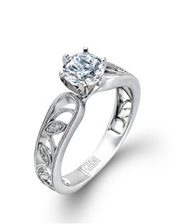 14K white gold ring comprised of 0.04ctw round white diamonds. excluding the center stone