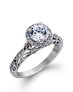 14K white gold ring comprised of 0.18ctw round white diamonds. excluding the center stone