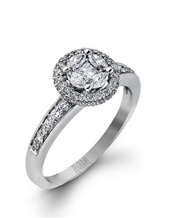 14K white gold ring comprised of 0.34ctw round white diamonds, 0.08ctw princess diamonds, and 0.20ctw marquise diamonds. excluding the center stone