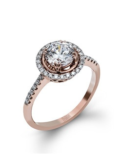 14K rose gold ring comprised of 0.21ctw round white diamonds. excluding the center stone