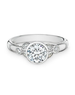18K white gold, diamonds, round, 1.50ct center, 0.25ct total weight side stones