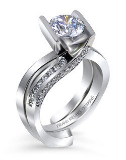 This 14kt White Semi-Mount is shown with a 1.5ct diamond center, and .40ctw diamonds. Available in 14/18k white, yellow, or rose gold, platinum, or palladium. Ring can be customized to fit any size/shape diamond or gemstone center. Center stone sold separately. The accompanying band shown is 14kt White and has .12ctw diamonds in a channel setting. Band sold separately.