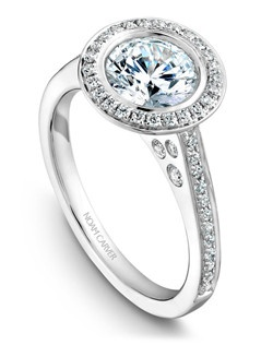 18k white gold modern halo with a bezel setting and a TCW of 0.25ct