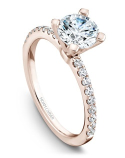 18k rose gold classic solitaire with 18 round diamonds and a TCW of 0.27ct