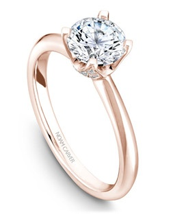 18k rose gold classic solitaire with 32 round diamonds and a TCW of 0.13ct