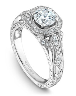 18k white gold vintage floral design with a halo, 44 round diamonds and a TCW of 0.26ct