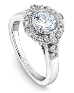 18k white gold vintage floral design with a halo, 20 round diamonds and a TCW of 0.26ct