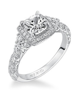 Alexandra, Vintage inspired diamond cushion halo engagement ring with cluster of 3 side accent stones and carved detail in satin finish. Available in Platinum, 18K and 14K gold. Price listed below is for the setting only. Settings can be custom made to fit any size or shape center stone. Total weight of semi-mount 1/3 Ct. Matching band available - Style number V557W-L