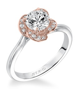 Josephina, Contemporary two tone solitaire diamond engagement ring with pave diamond accents within rose gold floral halo. Available in Platinum, 18K and 14K gold. Price listed below is for the setting only. Settings can be custom made to fit any size or shape center stone. Total weight of semi-mount 1/3 Ct. Matching band available - Style number V582ERW-L