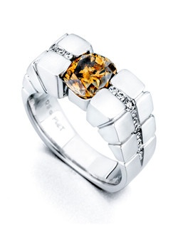 The Adamant ring contains 18 diamonds, totaling 0.33ctw. Shown with 2.41ct chocolate center diamond. Center stone sold separately, not included in price. Available in yellow, white, or rose gold, and platinum. Rings can be custom made to fit any size or shape diamond or color center stone. Price excludes center stone