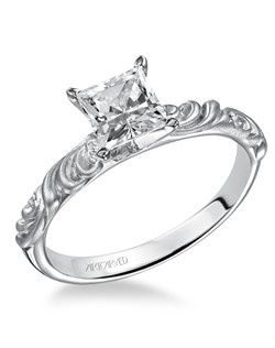 Sunrise, Vintage Inspired Diamond engagement ring with round center and a satin finished floral carving detail highlighted with diamonds. Available in Platinum, 18K and 14K gold. Price listed is an estimate for the setting only. Most settings can be custom made to fit different size or shape center stone. Matching band available - Style number V104W-L