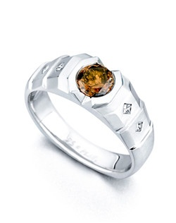 The Signet ring contains 4 diamonds, totaling 0.08ctw. Shown with a 0.89ct chocolate center diamond. Center stone sold separately, not included in price. Available in yellow, white, or rose gold, and platinum. Rings can be custom made to fit any size or shape diamond or color center stone. Price excludes center stone