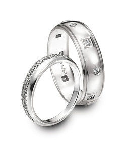 Michael Bondanza Pierpont platinum and diamond women's wedding band and Discovery platinum and diamond men's wedding band.