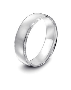 Tacori platinum wedding band featuring signature engraving and millgrain detail.