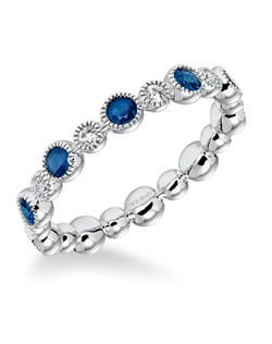 Bezel Set Blue Sapphire and Diamond with Milgrain Eternity Band. Price listed is an estimate only.