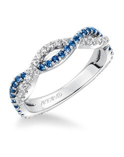 Blue Sapphire and  Diamond Twisted Eternity Band. Price listed is an estimate only.