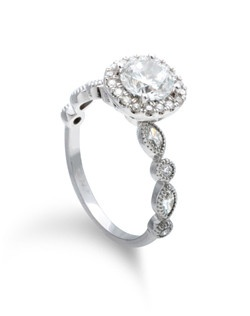 marquis and round diamond bands are a perfect compliment to this pave cushion halo.  Available for any size or shape center