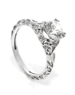 Open filagree creates a beatiful and soft feel for this vintage inspired hip ring.
