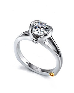 The Debut engagement ring contains 3 diamonds, totaling 0.05 ctw. Center stone sold separately, not included in price. Available in yellow, white, or rose gold, and platinum. Rings can be custom made to fit any size or shape diamond or color center stone. Price excludes center stone