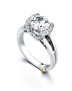 The Enamored engagement ring contains 34 diamonds, totaling 0.18 ctw. Center stone sold separately, not included in price. Available in yellow, white, or rose gold, and platinum. Rings can be custom made to fit any size or shape diamond or color center stone. Price excludes center stone