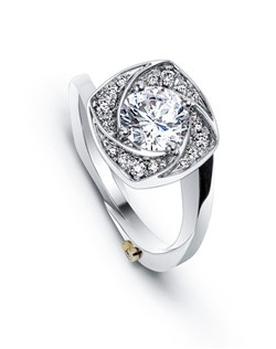 The Flutter engagement ring contains 25 diamonds, totaling 0.145ctw. Center stone sold separately, not included in price. Available in yellow, white, or rose gold, and platinum. Rings can be custom made to fit any size or shape diamond or color center stone. Price excludes center stone
