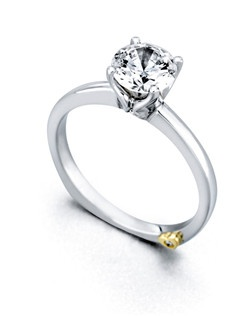 The Kiss engagement ring contains 3 diamonds, totaling 0.035ctw. Center stone sold separately, not included in price. Available in yellow, white, or rose gold, and platinum. Rings can be custom made to fit any size or shape diamond or color center stone. Price excludes center stone