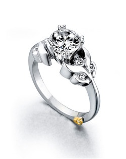 The Laurel engagement ring contains 7 diamonds, totaling 0.185ctw.  Center stone sold separately, not included in price. Available in yellow, white, or rose gold, and platinum. Rings can be custom made to fit any size or shape diamond or color center stone. Price excludes center stone