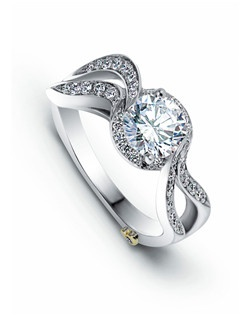 The Magic engagement ring contains 43 diamonds, totaling 0.285ctw. Center stone sold separately, not included in price. Available in yellow, white, or rose gold, and platinum. Rings can be custom made to fit any size or shape diamond or color center stone. Price excludes center stone