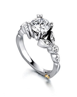 The Reminiscent engagement ring contains 9 diamonds, totaling 0.155ctw. Center stone sold separately, not included in price. Available in yellow, white, or rose gold, and platinum. Rings can be custom made to fit any size or shape diamond or color center stone. Price excludes center stone