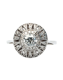 Zionsville is a rare, late Art Deco era 14k white gold and diamond ring centering a 0.45ct EGL certified Old European Cut diamond graded H color and VS2 clarity. Accented with a halo of twelve Single Cut diamonds gauged at approximately 0.08ct, Zionsville's unique shape is reminiscent of a sparkling starburst design. Zionsville is currently a size 7 and can be sized to fit